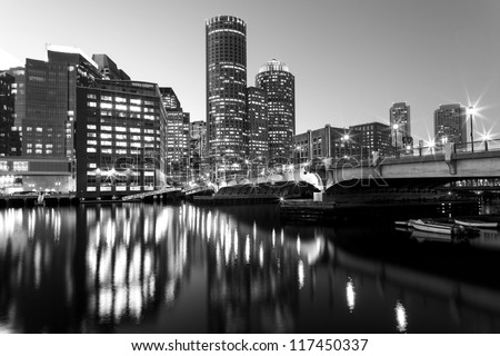 View of the Boston Harbor and Financial District in Boston, Massachusetts, USA at sunset. - stock photo