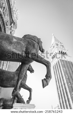 view of the Campanile with the statues of the horses of the San Marco Basilca in front, San Marco Square, Venice, Italy  - stock photo