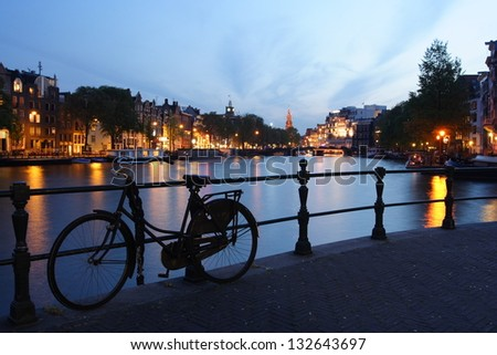 View of the canal in Amsterdam at night - stock photo