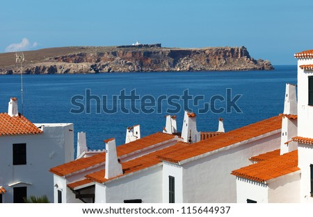 View of the Cap de Cavalleria from Fornells village,Menorca,Spain,focus on the houses - stock photo