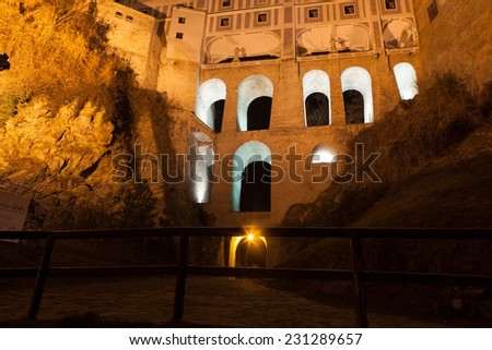 View of the Castle wing in Cesky Krumlov at night, the city is part of UNESCO heritage. - stock photo
