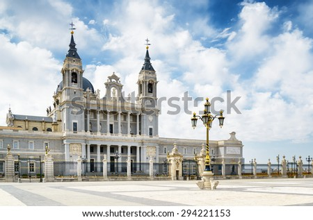 View of the Cathedral of Saint Mary the Royal of La Almudena from the Plaza de la Armeria (Armory Square) in Madrid, Spain. Madrid is a popular tourist destination of Europe. - stock photo