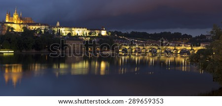 View of the Charles Bridge and Castle in Prague at night. - stock photo