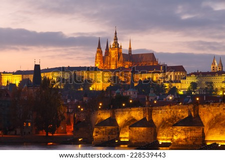 View of the Charles Bridge and Prague Castle at sunset. - stock photo