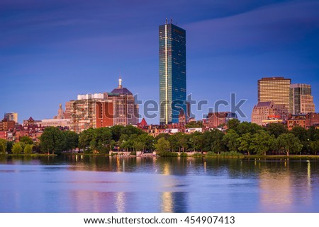 View of the Charles River and  buildings in Back Bay at twilight from Cambridge, Massachusetts. - stock photo