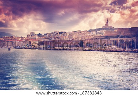 view of the city and port on the dramatic sunset sky background, Marseille, France, Cote d'Azur - stock photo