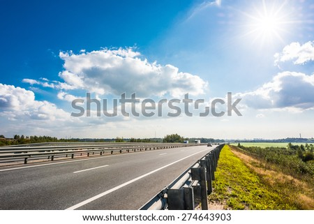 View of the city from the countryside road - stock photo