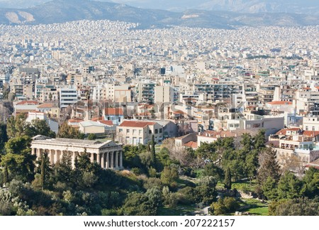 View of the city of Athens as seen from Areopagus or Mars Hill with the temple of Hephaistos (also known as Thissio or Theseion) on the foreground and mountains on the background, Greece. - stock photo