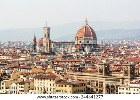 View of the city of Florence from Piazzale Michelangelo with focus on Duomo or cathedral Santa Maria del Fiore and Giotto's Campanile. - stock photo