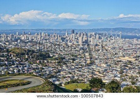View of the city of San Francisco from Twin Peaks on a sunny day with clouds. - stock photo