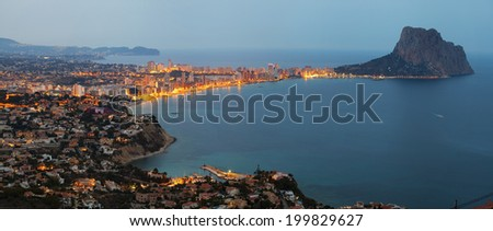 View of the coast and Mount Ifach at sunset (Calpe, Spain) - stock photo