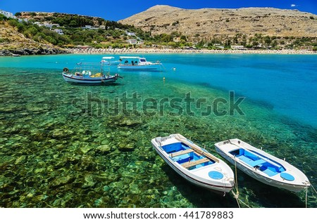 view of the coast with boats in Lindos bay, Greece - stock photo