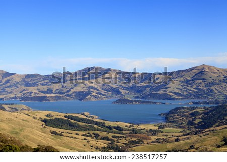View of the coastline around Akaroa harbour, Canterbury region, South Island of New Zealand. - stock photo