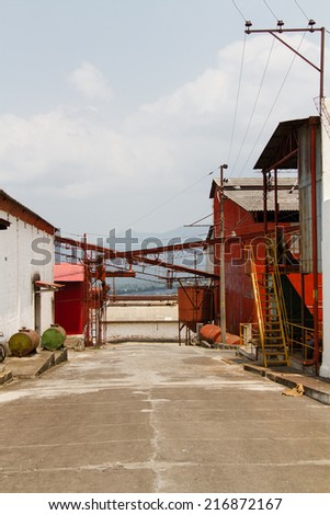 View of the coffee mill where coffee is beeing sorted, the shell is removed, beans are cleaned, roasted and burned. At the end coffee dryies and is beeing sold to local retailers. Juyaua, El Salvador - stock photo