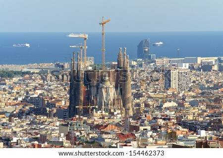 View of the construction Sagrada Familia and over the sea of houses in Barcelona. With approx. 1.6 million inhabitants, Barcelona is the capital from Catalonia - stock photo