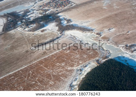 View of the earth from an airplane window - stock photo