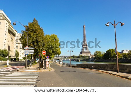 View of the Eiffel tower and Bir-Hakeim bridge from Avenue du President Kennedy, Paris, France - stock photo