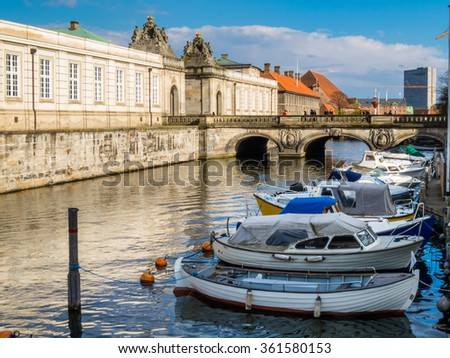 View of the embankment and boats on the channel of Copenhagen, Denmark - stock photo