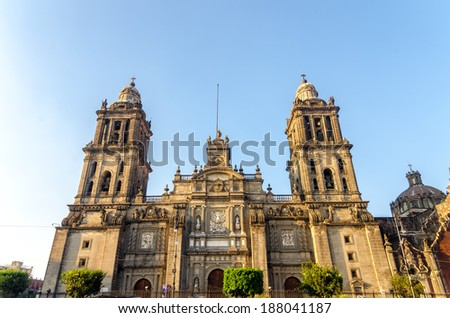 View of the facade of the cathedral in Mexico City as seen from the Zocalo - stock photo