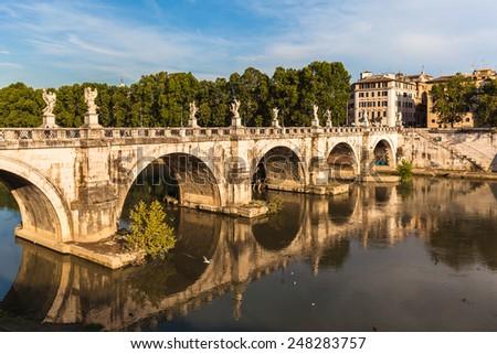 View of the famous bridge Ponte Sant'Angelo in sun light, Rome, Italy - stock photo