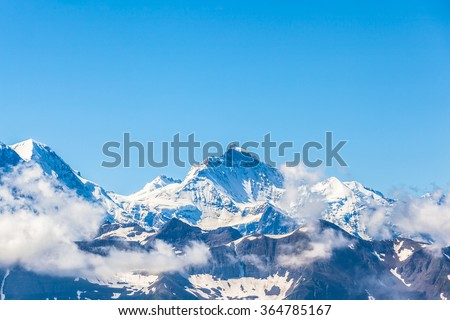 View of the famous peak Jungfrau of the swiss Alps on Bernese Oberland in Switzerland. One of the main summits of the Bernese Alps, located between the southern canton Bern and northern canton Valais. - stock photo