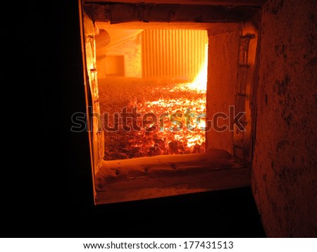 view of the fire grate boiler incinerating coal - stock photo