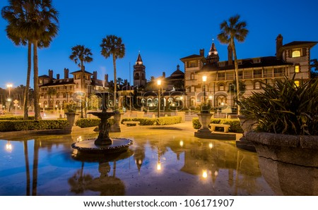 View of the Flagler College facade in St. Augustine, Florida, at dusk.  This building is a National Landmark and used to be the exclusive Ponce de Leon Hotel, built by Henry M. Flagler. - stock photo