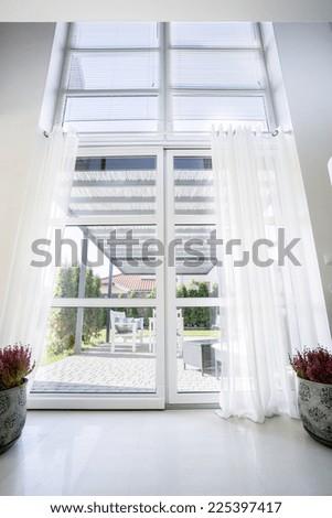 View of the garden through a glass door - stock photo