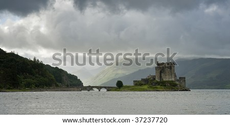 View of the gloomy Eilean Donan castle in Scotland - stock photo