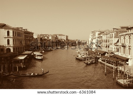 View of the Grand Canal from the famous Rialto bridge shows boats, stations, restaurants, etc. - stock photo