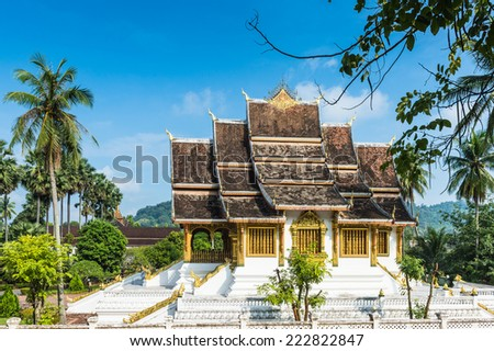 View of the  Haw Pha Bang Buddha temple of the National museum complex of Luang Prabang, Laos. - stock photo