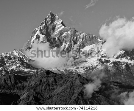 View of the himalayan peak Machhapuchre from the south  from a motor-paraplane (black and white) - Nepal - stock photo