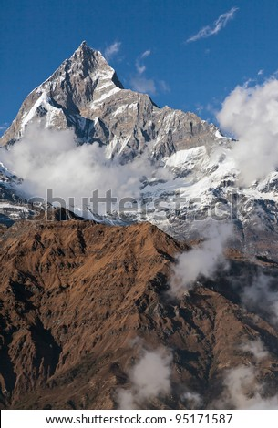 View of the himalayan peak Machhapuchre from the south (view from the trike) - Nepal - stock photo