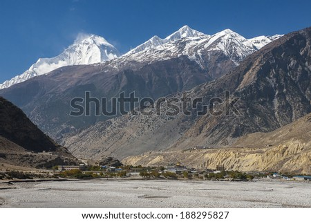 view of the Himalayas (Dhaulagiri) and the village of Jomsom  - stock photo
