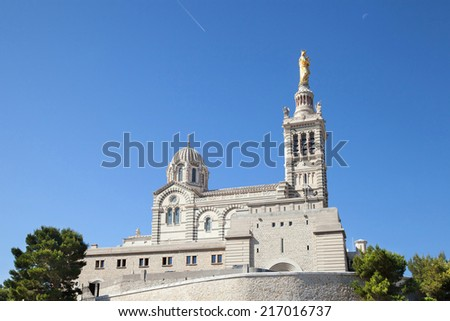 """View of the historic church """"Notre Dame de la Garde"""" of Marseille in South France  - stock photo"""