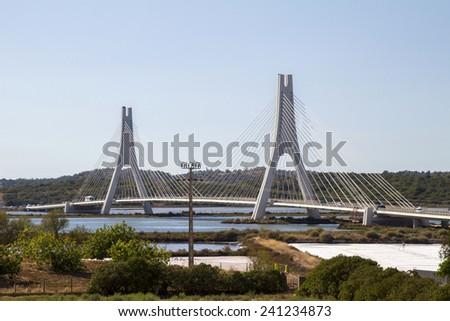 View of the iconic bridge over Portimao's Arade river. - stock photo