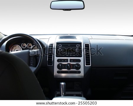 View of the interior of a modern automobile showing the dashboard and rear view mirror. A clipping path of the windshield and mirror are included so you can replace it with whatever you like! - stock photo