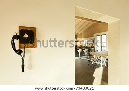 view of the kitchen and phone vintage on the wall - stock photo