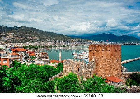 View of The Kizil Kule (Red Tower) is a historical tower in the Turkish city of Alanya - stock photo