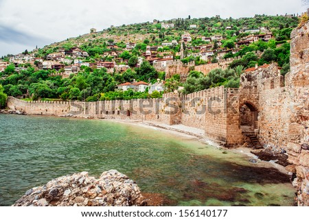 View of The Kizil Kule (Red Tower) is a historical tower in the Turkish city of Alanya. - stock photo