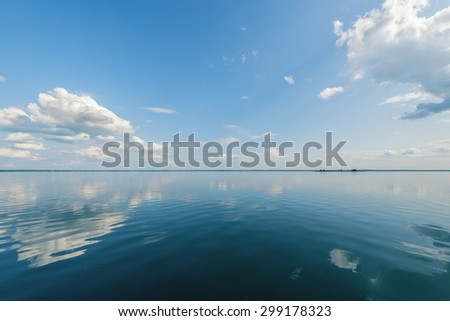 View of the lake at windless weather time. - stock photo