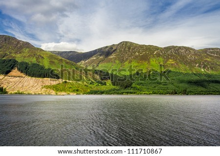 View of the lake in the mountains in Scotland in the summer - stock photo