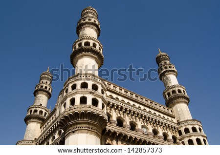 View of the landmark Charminar tower in central Hyderabad, India.   Islamic architecture built during the Mughal Empire and housing a mosque it is one of the most well known landmarks in the city. - stock photo