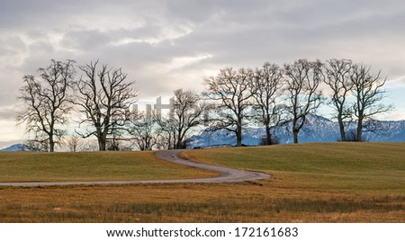 View of the landscape near Munich in the Alps of Bavaria after the wintertime - stock photo