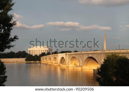 View of the Lincoln Memorial, Washington Monument and Memorial Bridge from the banks of the Potomac River, Sundown Washington DC - stock photo
