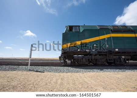View of the locomotive of the Shanghai - Lhasa train stopped in a train station in Tibet. China 2013. - stock photo