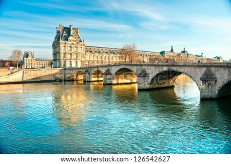 View of the Louvre Museum and Pont des arts, Paris - France - stock photo