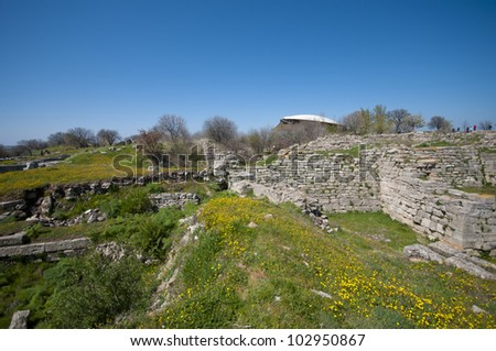 View of the main hill of the ancient city of Troy (3000BC - 1BC) with ruins of twelve cities built on top of each other (Troy I to Troy XII), in Anatolia, Turkey. - stock photo