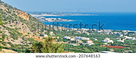 View of the Malia Hersonissos harbor at sunrise near Heraklion, Crete, Greece with the mountains touching the sea - stock photo