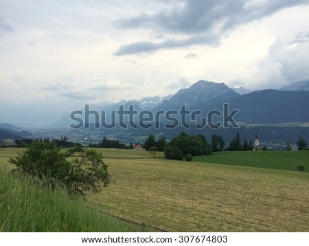View of the meadow and mountains - stock photo